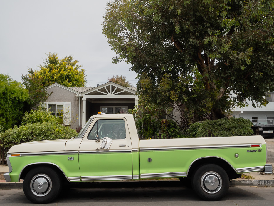 green and white pickup